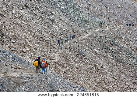 LAKE LOUISE, CANADA - SEPT 17, 2016: Hikers traverse the rocky trail of Mount Temple at Sentinel Pass in the Larch Valley near Lake Louise in Banff National Park, Alberta.