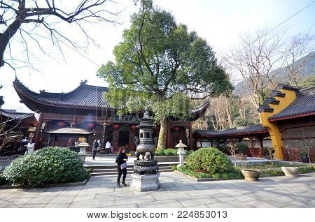 HANGZHOU, CHINA - JAN 08, 2018: View of architecture of old Lingyin Temple in Hangzhou, China. The temple is one of the largest and wealthiest Buddhist temples in China