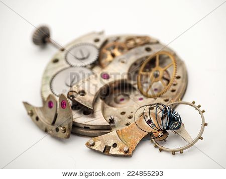 It's Spring Time! Antique pocket watch in pieces and in need of a new spring.