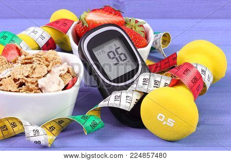 Glucometer with result of measurement sugar level, healthy food, dumbbells for fitness and tape measure, concept of diabetes, slimming, healthy lifestyle