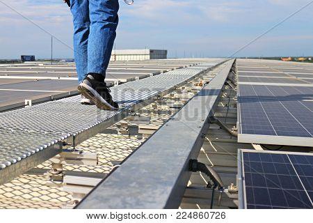 Solar PV Rooftop with Technician Walking on Walkway