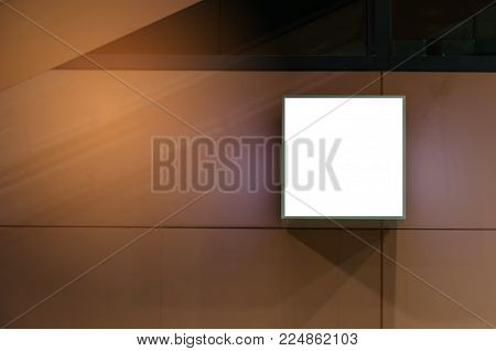 cube shaped blank showcase billboard or advertising light box on wall for your text message or media content at airport or subway train station, advertisement, commercial and marketing concept
