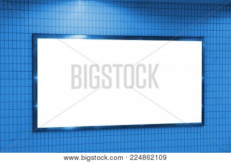 blank advertising billboard or light box showcase on wall at airport or subway train station, copy space for your text message, media content, advertisement, commercial, marketing concept, blue color
