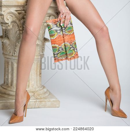 Beautiful women legs in high heel shoes on a white background.