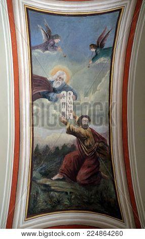 STITAR, CROATIA - JUNE 24: God gives Moses the Ten Commandments, fresco in the church of Saint Matthew in Stitar, Croatia on June 24, 2017.
