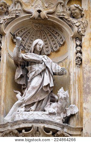 ROME, ITALY - SEPTEMBER 05: Statue of Saint Martha of Bethany on facade of Santa Maria Maddalena Church in Rome, Italy on September 05, 2016.