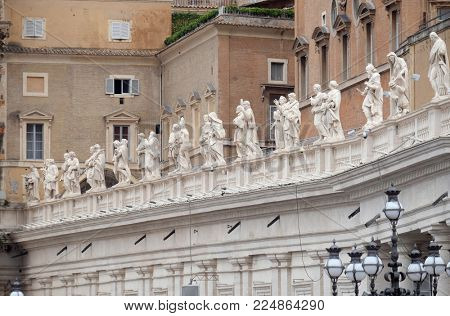 ROME, ITALY - SEPTEMBER 05: Gallery of saints, fragment of colonnade of St. Peters Basilica. Papal Basilica of St. Peter in Vatican in Rome, Italy on September 05, 2016.