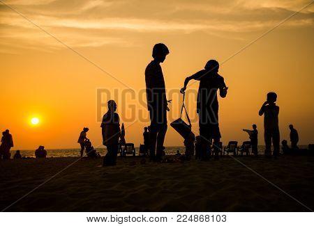 Mararikulam, India - December 30 2017: Beautiful Silhouette Of People Doing Different Activities On