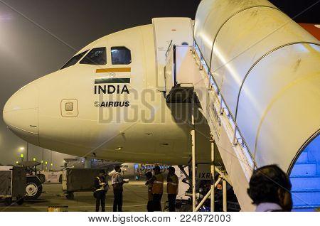 Kochi, India - January 11 2018: Air Asia flight from Kochi to Bangalore at Cochin airport at night in Kochi, India