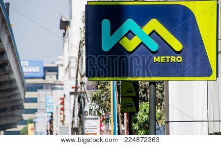 Kochi, India - January 11 2018: Kochi metro sign infront of a metro station in Kochi, India