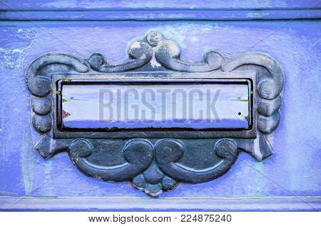 Abstract blue mailbox or letterbox antique doors for sanding letters or mail close up
