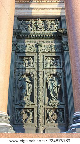 ST. PETERSBURG, RUSSIA - JANUARY 23, 2018: Saint Isaac's Cathedral Bas-Relief Mosaic on Bronze Front Door Gate. St. Petersburg Historical Landmark, Outdoor Detail of Orthodox Basilica Decor.