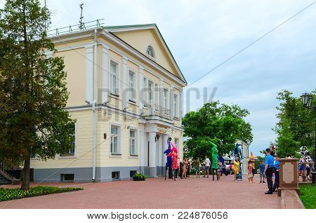 VITEBSK, BELARUS - JULY 13, 2016: Skomorokhs on stilts are near puppet theater during festival of Slavic Bazaar, Vitebsk, Belarus