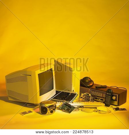 picture of various electronic scrap in yellow ambiance