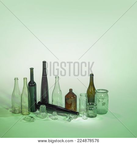 waste glass bowls and bottles in green ambiance