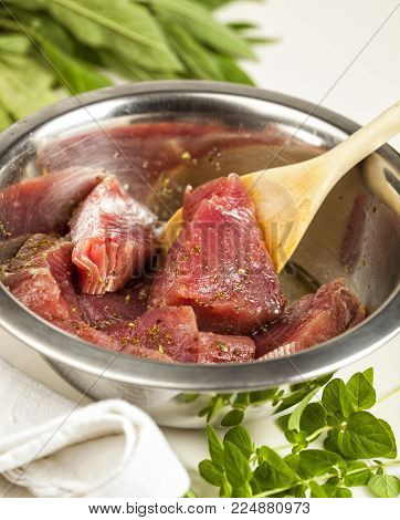 Preparing Marinated Tuna Fish With Herbs, Spices And Olive Oil.