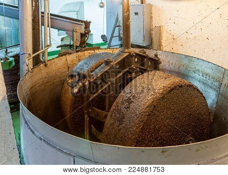 Olive press at an olive oil manufacturing plant.