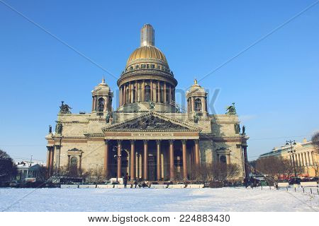 Winter View of Saint Isaac's Cathedral in St. Petersburg, Russia. Main Landmark and Famous City Symbol on Cold Snowy Sunny Day Nature. Outdoor Scene with Blue Sky Background and No People Around.