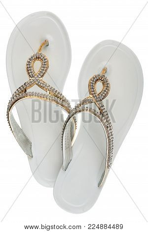 Luxury, decorated with rhinestone white beach flip flops, isolated on a white background