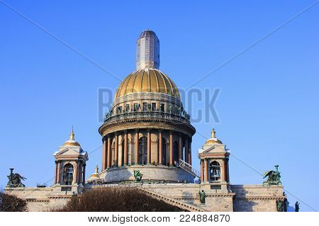 St. Petersburg Saint Isaac's Cathedral Dome View. Orthodox Active Church and Religious Landmark in Russia. Classical Monumental Basilica Building Architecture on Clear Blue Sky Background.