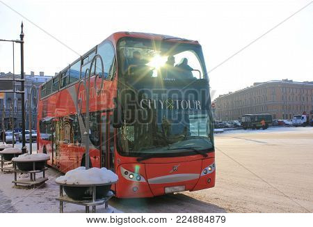 ST. PETERSBURG, RUSSIA - JANUARY 23, 2018: Sightseeing Bus (Hop On Hop Off) on Saint Isaac's Square. Red Tourist Tourist Bus Helps Travelers Explore City Fast with Guided Tours in Different Languages.