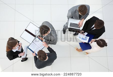 business team with financial documents standing in the lobby