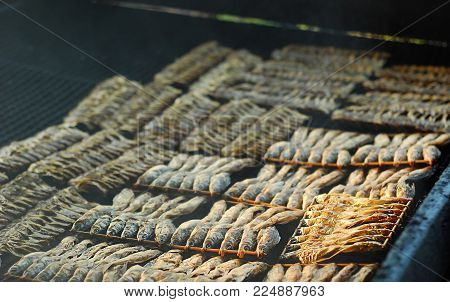 Thai trditional smoked dried fish to preserve food.