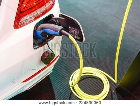 Power Supply Connect To Electric Car For Add Charge To The Battery. Charging Re Technology Industry