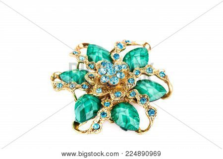 Ancient style brooch with stones isolated on white background.