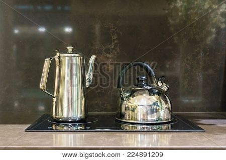 Close-up Of Stainless Steel Cooking Pot And Pan On Induction Hob In Modern Kitchen. Modern Kitchen P