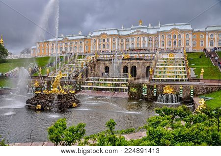 MAY 2015, PETERHOF PALACE - SAINT PETERSBURG, RUSSIA: Peterhof Palace, famous monumental building with water streams and large golden statues around it