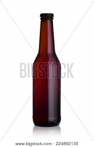 Brown glass stout beer bottle with black cap isolated on white background with reflection