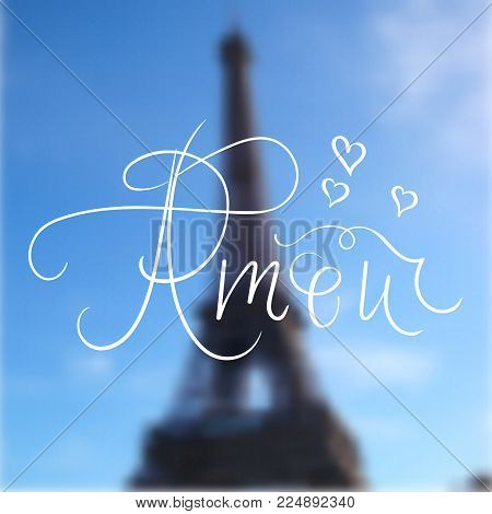 Romantic hand written calligraphic inscription amour on blurred background of Eiffel Tower. Love quote for wedding cards, valentines day. Vector. Design element fo posters, cards.
