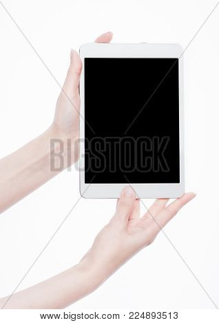 Female hands holding graphic tablet isolated on white background.