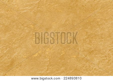 Golden yellow seamless venetian plaster background stone texture. Traditional venetian plaster stone texture grain pattern drawing. Gold grunge texture. Golden seamless stone texture background. Golden stucco seam less texture