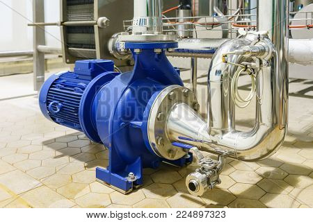 Water Centrifugal pump and motor line with pipe rack in power plant construction site industrial, demineralized water