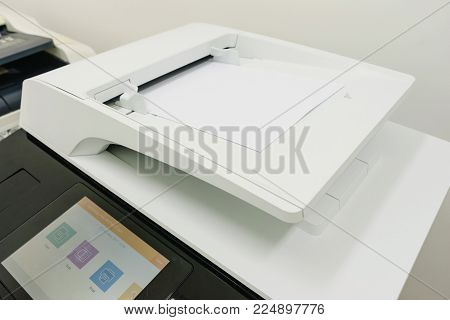 photocopier is a machine that makes paper copies of documents and other visual images ,close-up multi-function device, printer scanner, copier