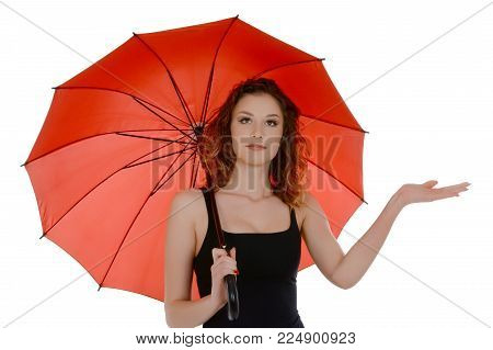 Young woman with red umbrella checking if it's raining, isolated on white background