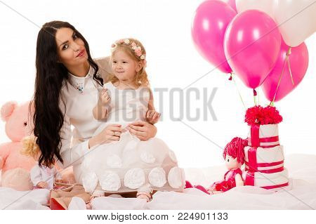 beautiful brunette woman with a little girl on birthday