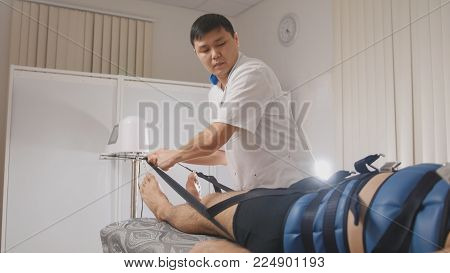 Osteopathic doctor perform procedure, stretching the spine, chiropractic, Asian Tibetan medicine, close up