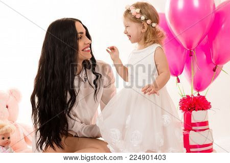 brunette woman with a little girl on birthday