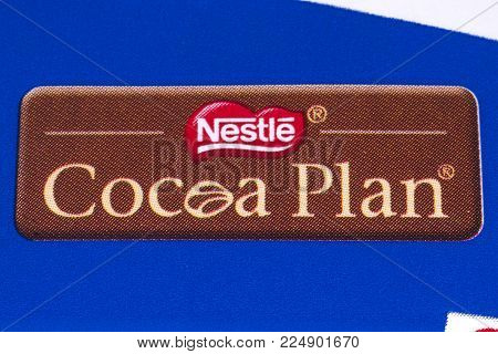 LONDON, UK - DECEMBER 18TH 2017: A close-up of the Nestle Cocoa Plan symbol on a Crunch chocolate bar, on 18th December 2017.  The plan aims to improve the lives of cocoa farmers and the quality of their products.