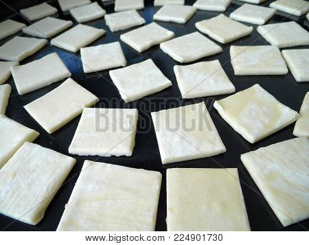 pastries made in the oven, cook the dough in the oven, the dough raw images in tray