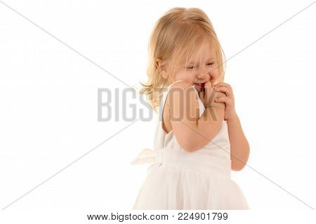 shy little baby in white dress isolated on white