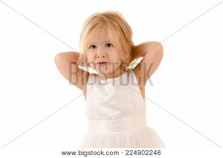 pensive little girl in white dress  isolated on white