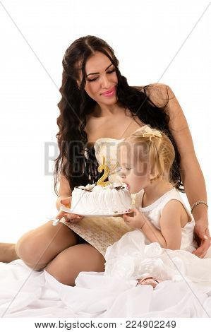 mother and daughter eating cake on birthday