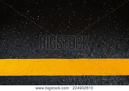 Close up asphalt road texture line yellow background