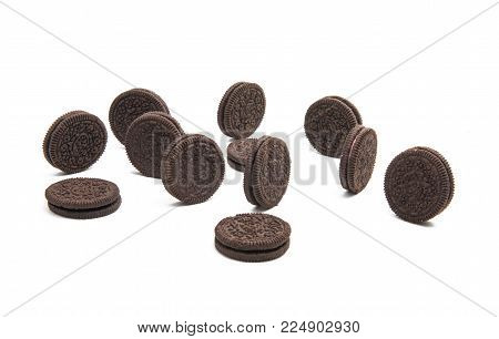 Double Chocolate Cream Sandwich Cookies On White Background