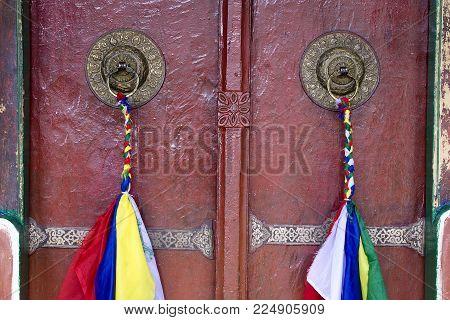 Door handle of gate door of gompa in tibetan buddhist monastery. Ladakh, Jammu Kashmir, India . Close up