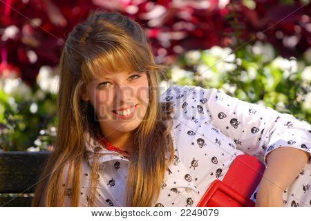Teenage Girl Lying On Bench